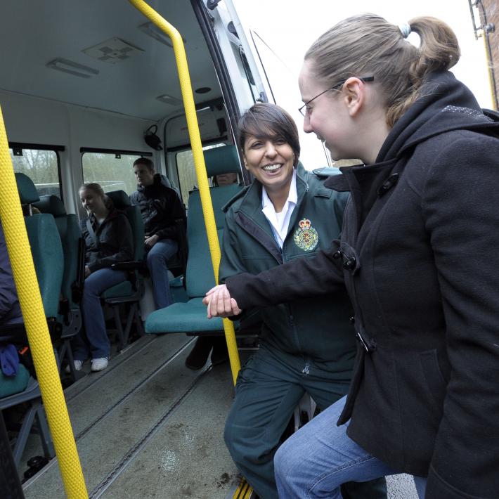 ambulance-female-helping-patient-patient-transport