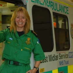 ambulance-female-in-front-of-ambulance