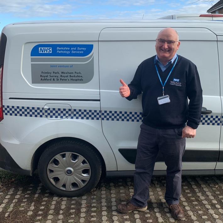 Martin Healy, driver, next to trust van