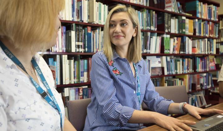 Outreach librarian with colleague