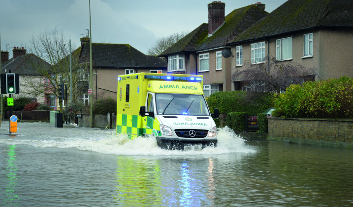 Ambulance driving through floodwaters
