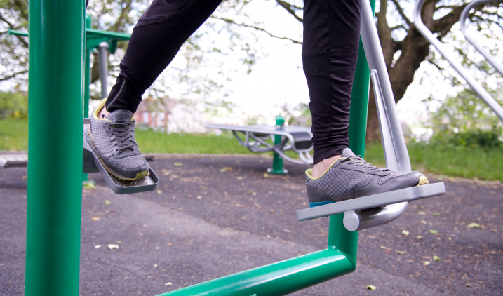 Feet on outside exercise equipment