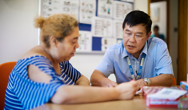 male learning disability nurse with patient