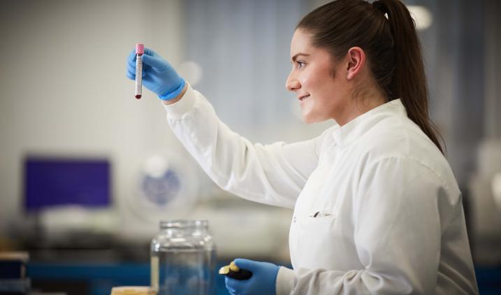 Female Healthcare Science Worker In Lab Coat