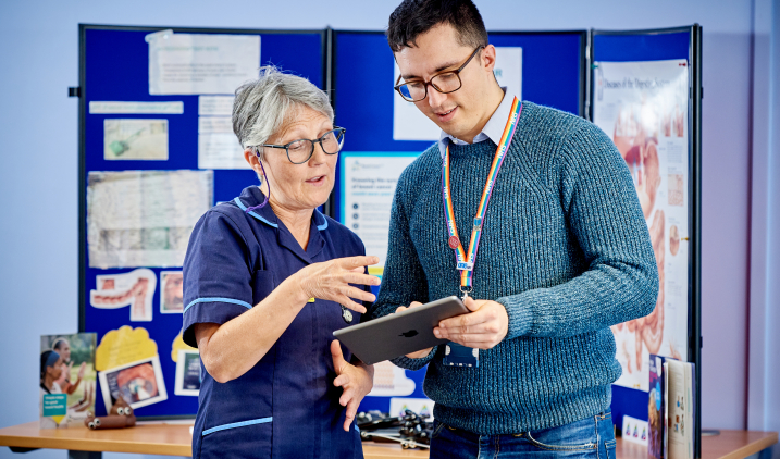 Nurse with libraries staff