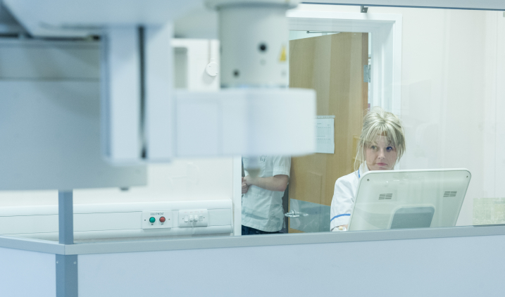 Female member of staff with scan equipment