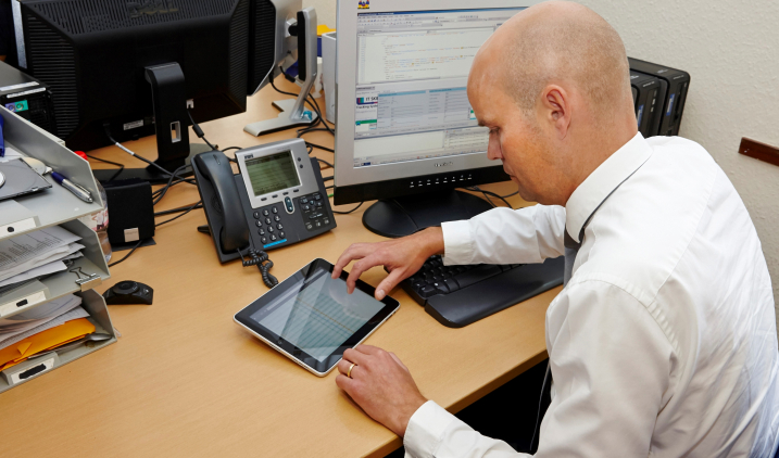 male worker checking computertablet - Should You Make A Career Change Do Self Assessment And Analysis Before Deciding