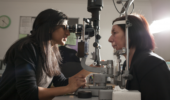 Female eye doctor with patient