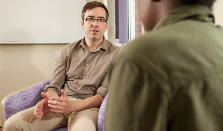 Male psychologist with patient