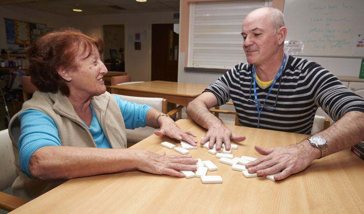 Male social care worker with elderly female client