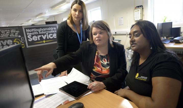 Health informatics trainer with staff