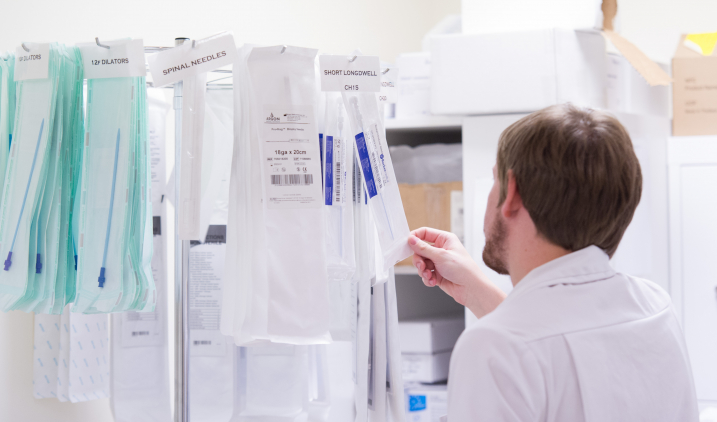 decontamination staff with needles