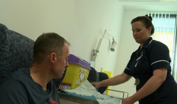 district nurse with patient