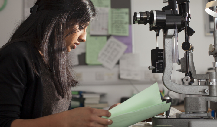 female doctor looking at notes