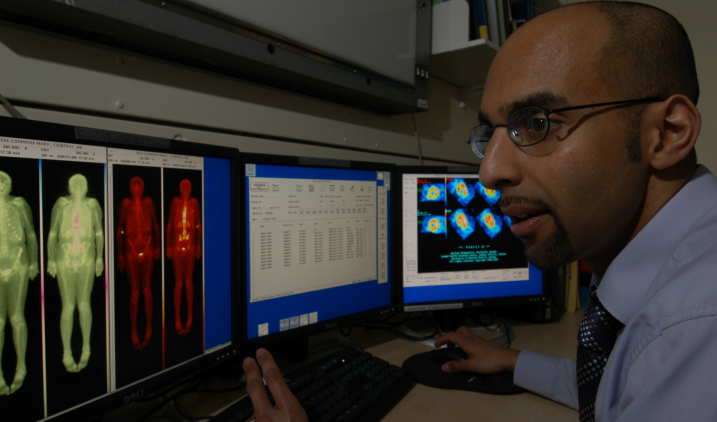 healthcare-science-male-examining-photos-gamma-camera