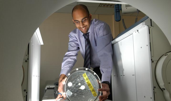 Healthcare scientist man with gamma camera