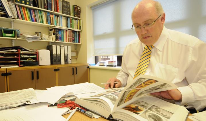 male-in-office-reading