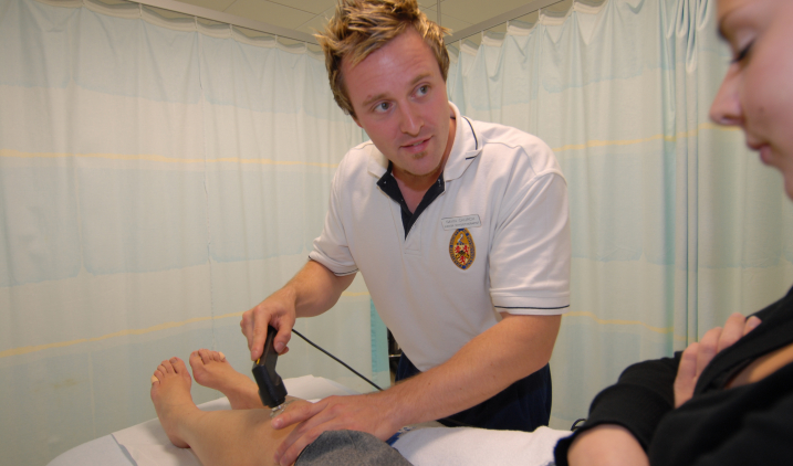 physiotherapist with patient