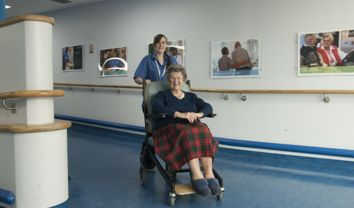 female-pushing-patient-on-wheelchair