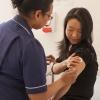 practice nurse with patient