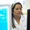 Female worker with headset